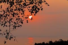 Sunset at hill among lagoon Stock Image