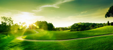 Sunset hill. Panoramic view of nice green hill on blue sky background Stock Photo