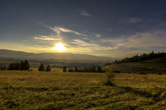 Sunset on the hill. Sunset in Sumuleu, Harghita County, Romania royalty free stock photo