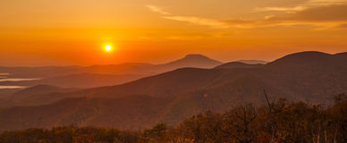 Sunset in hills Stock Photos