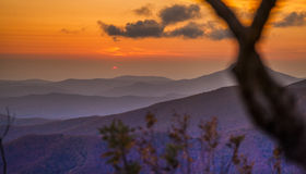 Sunset in hills Stock Images