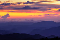 Sunset in hills. Silhouettes of hills in valley on sunset. Pothamedu viewpoint, Munnar, Kerala, India Stock Photos