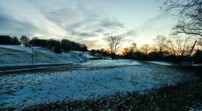 Sunset hillside in blue winter stock photo