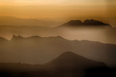 Sunset on hilltops in the mist Stock Image