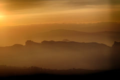 Sunset on hilltops in the mist Royalty Free Stock Photography