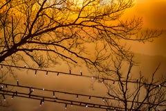 Sunset on hilltops in the mist Stock Photos