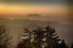 Sunset on hilltops in the mist Royalty Free Stock Images