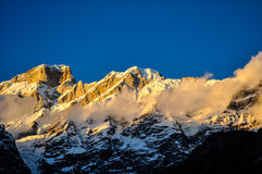 Sunset in Himalayas. A golden colored sunset taken at 3500 mtrs above sea level in a small town at Kedarnath,India Stock Photo