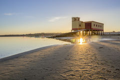 Sunset and historic life-guard building in the foreground, in Algarve Stock Image