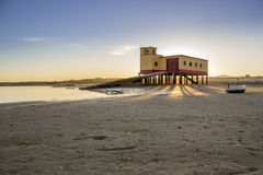 Sunset and historic life-guard building in the foreground, at Fu Stock Photography