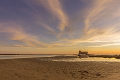 Sunset and historic life-guard building at Fuseta fishing town, Algarve. Sunset and historic life-guard building at Fuseta fishing town, in Ria Formosa wetlands Royalty Free Stock Images
