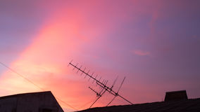 Sunset at home with antenna Royalty Free Stock Photo