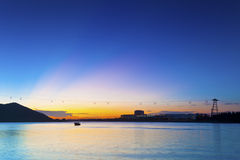 Sunset in Hong Kong along seashore and mountains Royalty Free Stock Images