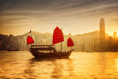 Sunset at Hong Kong with traditional cruise sailboat Royalty Free Stock Images