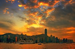 The sunset of Hongkong. The sunset has tinted the sky with orange.These photo is taken at Hongkong at evening Royalty Free Stock Images