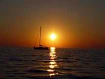 Sunset horizon. And small ship in Piran Slovenia Royalty Free Stock Photo