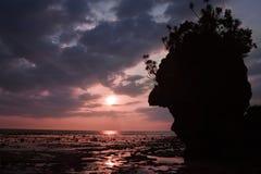 Sunset horizon with cliff silhouette Stock Photos
