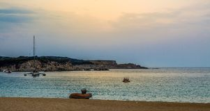 Sunset on the horizont with small boats Stock Images