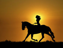 Sunset Horse Ride 1 Stock Photography
