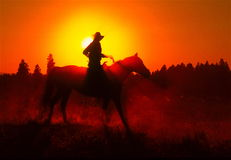 Sunset horse rider. Royalty Free Stock Photography