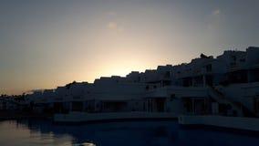 Sunset hotel pool stock photos