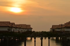 Sunset and houses above water. A beautiful shot at sunset in Malaysia at the Indian Ocean. High vivid colors Stock Photography