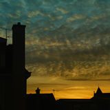 Sunset on houses Stock Photos