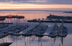 Sunset in Howth marina. With docked yachts Stock Photos
