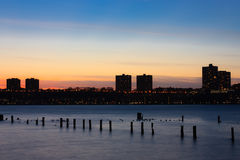 Sunset on the Hudson river with silhouette of New Jersey Royalty Free Stock Images
