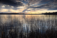 Sunset Hues. View of a beautiful sunset over a lake in Haliburton, Ontario stock images