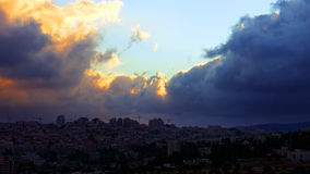 Sunset with huge cumuli clouds over the city. Jerusalem sunset at night dusk Stock Photos