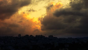 Sunset with huge cumuli clouds over the city. Jerusalem sunset at night dusk Royalty Free Stock Photography