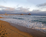 Sunset at Huntington Beach. Famous Huntington Beach pier during a Southern California sunset Royalty Free Stock Photography