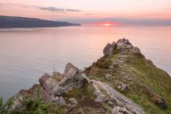 Sunset from hurlstone point exmoor. Sunset hurlstone point near porlock exmoor somerset uk royalty free stock image
