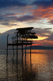 Sunset with hut silhouette. royalty free stock photos