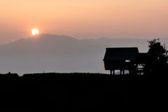 Sunset hut silhouette mountain view Royalty Free Stock Image