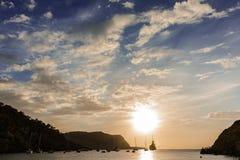 Sunset in Ibiza island. Quiet scene: Sailboats in a harbor at sunset. Mediterranean sea of Ibiza island Royalty Free Stock Photography