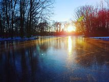 Sunset on ice. Dutch sunset at a beautyfull natural mirror on a cold winterday Stock Photos