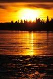 Sunset on ice lake Stock Image
