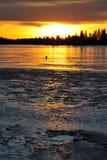 Sunset on ice lake Royalty Free Stock Photography