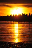 Sunset on ice lake royalty free stock images