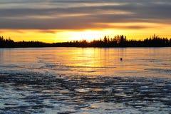 Sunset on ice lake Stock Photo
