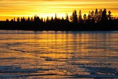 Sunset on ice lake Royalty Free Stock Photo