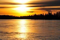 Sunset on ice lake Stock Photos
