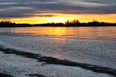 Sunset on ice lake Stock Images