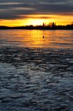 Sunset on ice lake Stock Photography
