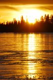 Sunset on the ice lake Royalty Free Stock Photos