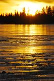 Sunset on the ice lake Royalty Free Stock Photography