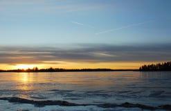 Sunset on the ice lake Stock Photo