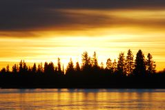 Sunset on the ice lake Stock Photos